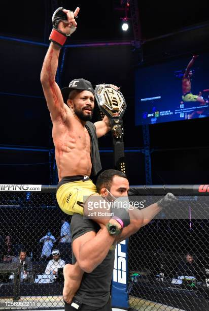Deiveson Figueiredo of Brazil celebrates after defeating Joseph Benavidez in their UFC flyweight championship bout during the UFC Fight Night event...