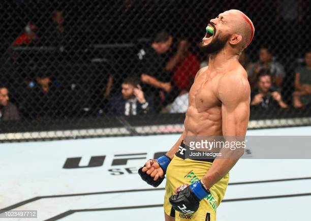 Deiveson Figueiredo of Brazil celebrates after his TKO victory over John Moraga in their flyweight fight during the UFC Fight Night event at Pinnacle...