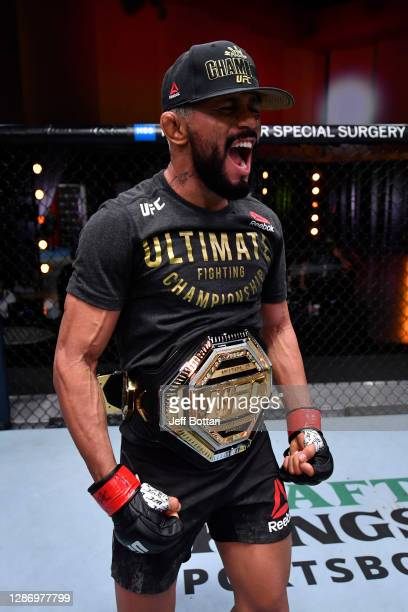 Deiveson Figueiredo of Brazil celebrates his submission victory over Alex Perez in their flyweight championship bout during the UFC 255 event at UFC...