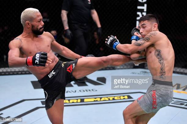 Deiveson Figueiredo of Brazil kicks Alex Perez in their flyweight championship bout during the UFC 255 event at UFC APEX on November 21, 2020 in Las...