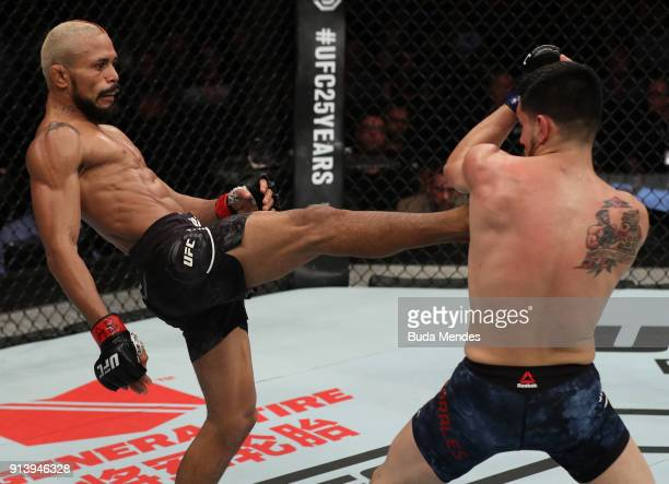 Deiveson Figueiredo of Brazil kicks Joseph Morales in their flyweight bout during the UFC Fight Night event at Mangueirinho Arena on February 03 2018...