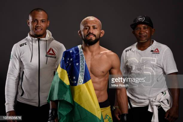 Deiveson Figueiredo of Brazil poses for a portrait backstage with his team after his victory over John Moraga during the UFC Fight Night event at...