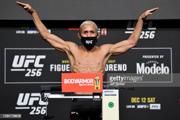 Deiveson Figueiredo of Brazil poses on the scale during the UFC 256 weigh-in at UFC APEX on December 11, 2020 in Las Vegas, Nevada.