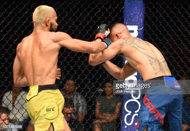 Deiveson Figueiredo of Brazil punches John Moraga in their flyweight fight during the UFC Fight Night event at Pinnacle Bank Arena on August 25 2018...