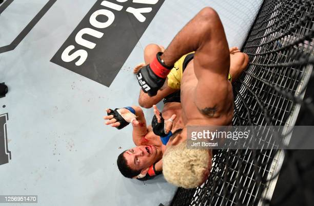 Deiveson Figueiredo of Brazil punches Joseph Benavidez in their UFC flyweight championship bout during the UFC Fight Night event inside Flash Forum...