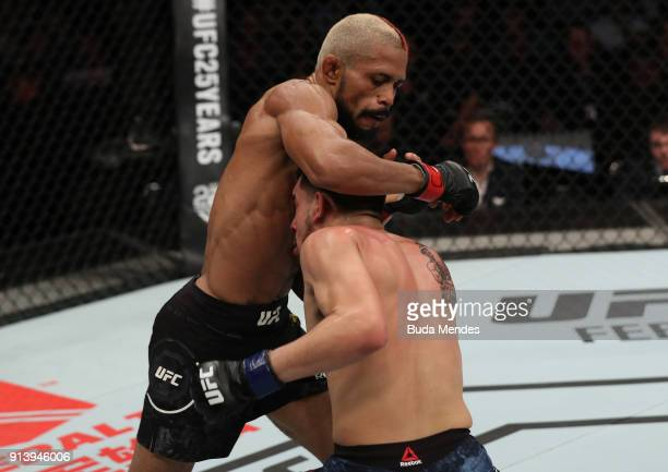 Deiveson Figueiredo of Brazil punches Joseph Morales in their flyweight bout during the UFC Fight Night event at Mangueirinho Arena on February 03...