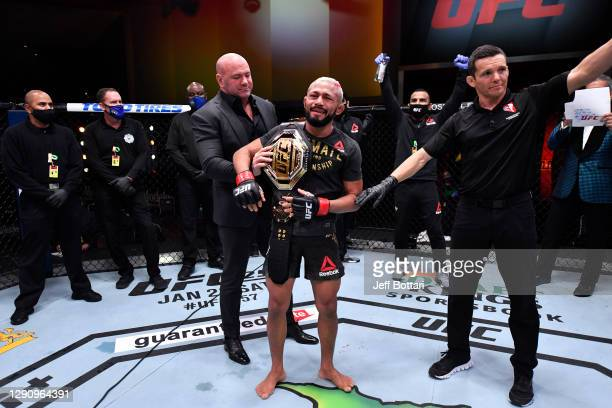 Deiveson Figueiredo of Brazil reacts after his flyweight championship bout was declared a majority draw during the UFC 256 event at UFC APEX on...