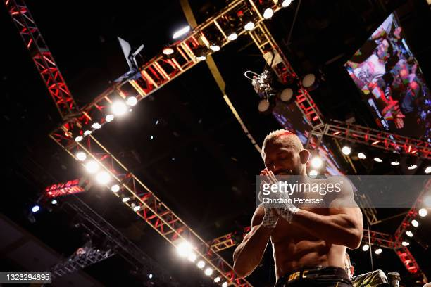 Deiveson Figueiredo of Brazil reacts to the fans after being defeated by Brandon Moreno of Mexico during their UFC 263 flyweight championship match...