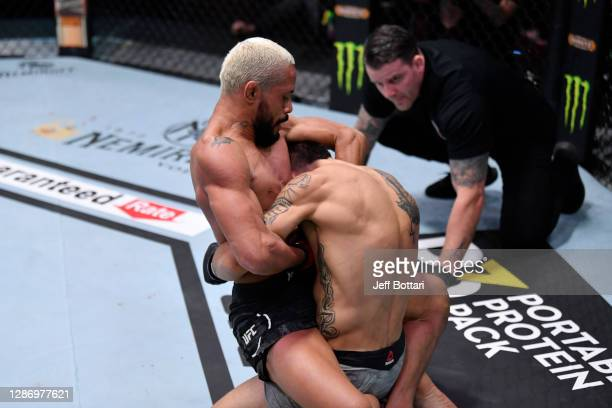 Deiveson Figueiredo of Brazil submits Alex Perez in their flyweight championship bout during the UFC 255 event at UFC APEX on November 21, 2020 in...