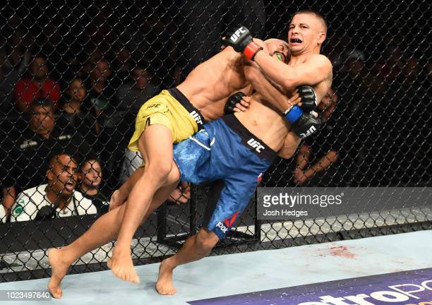 Deiveson Figueiredo of Brazil takes down John Moraga in their flyweight fight during the UFC Fight Night event at Pinnacle Bank Arena on August 25...