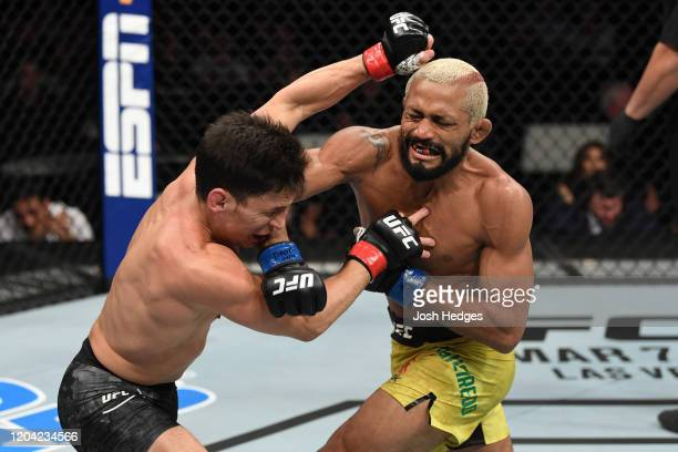 Deiveson Figueiredo punches Joseph Benavidez in their flyweight championship bout during the UFC Fight Night event at Chartway Arena on February 29,...