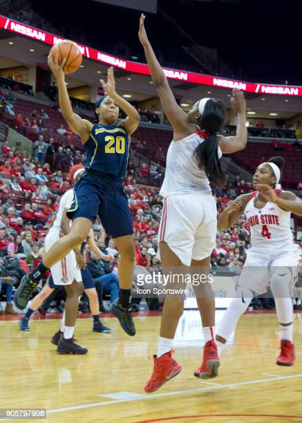 Deja Church of the Michigan Wolverines attempts a lay up during the game between the Ohio State Buckeyes and the Michigan Wolverines at the Value...