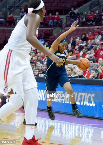 Deja Church of the Michigan Wolverines reacts to trying to keep the ball from going out of bound as she dribbles down the court during the game...