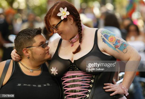 Deja holds on to her lesbian partner Jukie during the 2004 Pride Parade June 27, 2004 in San Francisco. Tens of thousands lined the streets of San...