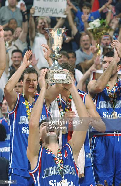 Dejan Bodiroga of Yugoslavia holds up the World Championship trophy after defeating Argentina in the Gold medal game of the World Basketball...