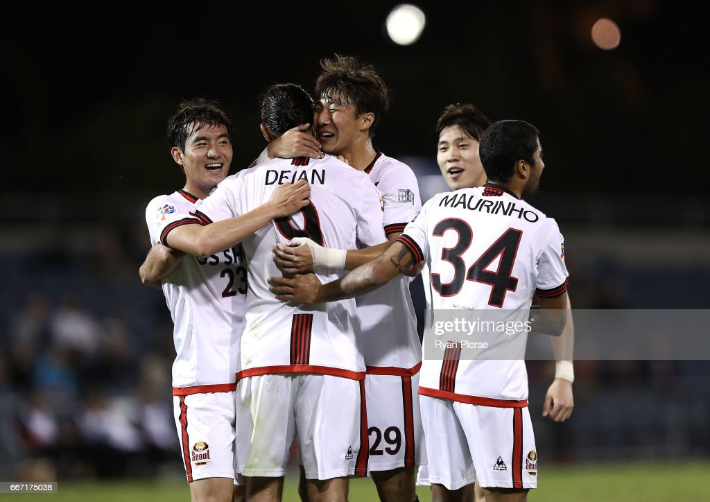 Dejan Damjanovic of FC Seoul is congratulated by Hwang Ki-Wook and Lee Seok-Hyun of FC Seoul after scoring his teams third goal during the AFC Champions League match between the Western Sydney Wanderers and FC Seoul at Campbelltown Sports Stadium on April 11, 2017 in Sydney, Australia.