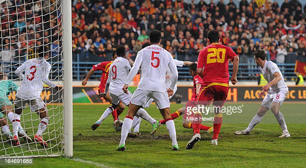 Dejan Damjanovic of Montenegro scores their first goal during the FIFA 2014 World Cup Group H Qualifier between Montenegro and England at City...