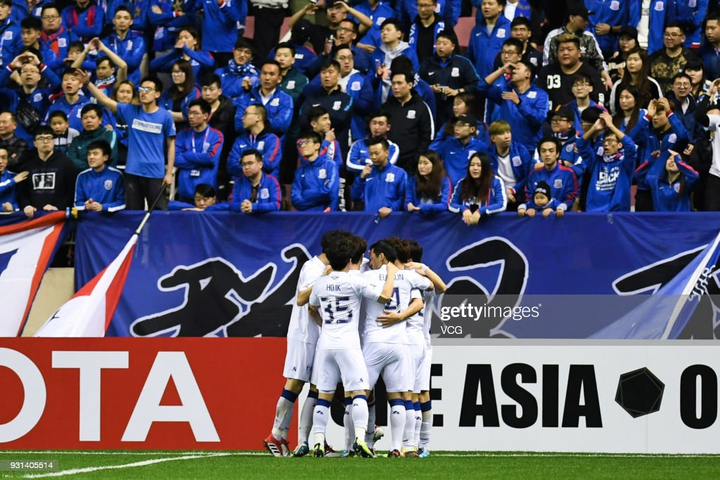 Dejan Damjanovic #10 of Suwon Samsung Bluewings celebrates with team mates after scoring a goal during the 2018 AFC Champions League Group H match between Shanghai Shenhua and Suwon Samsung Bluewings at Hongkou Football Stadium on March 13, 2018 in Shanghai, China.