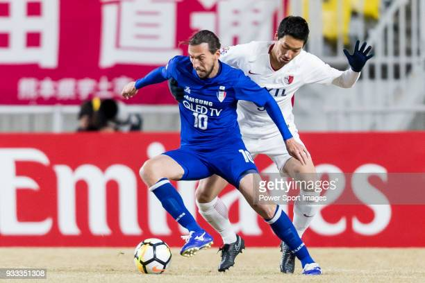 Dejan Damjanovic of Suwon Samsung Bluewings fights for the ball with Yuma Suzuki of Kashima Antlers during the AFC Champions League 2018 Group H...