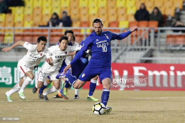 Dejan Damjanovic of Suwon Samsung Bluewings takes a penalty which was saved during the AFC Champions League Group H match between Suwon Samsung...