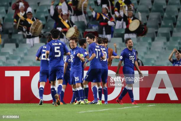 Dejan Damjanovic of the Bluewings celebrates with team mates after scoring the first goal during the AFC Asian Champions League match between Sydney...