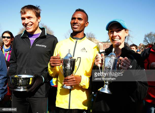Dejan Gebremeskel of Ethopia , Ben True of the United States , and Molly Huddle of the United States pose for a portrait with their trophies in the...