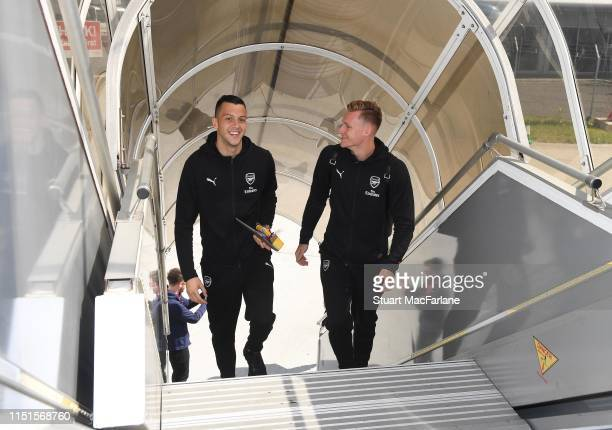 Dejan Iliev and Bernd Leno of Arsenal board the team flight at Luton Airport on May 25 2019 in Luton England