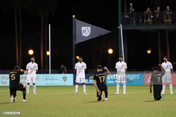 Dejan Jakovic, Brian Rodriguez and Latif Blessing of Los Angeles FC kneel during the national anthem before their match against the Los Angeles...