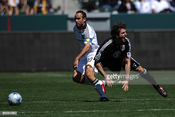 Dejan Jakovic of DC United fights for the ball with Landon Donovan of the Los Angeles Galaxy at the Home Depot Center on March 22 2009 in Carson...
