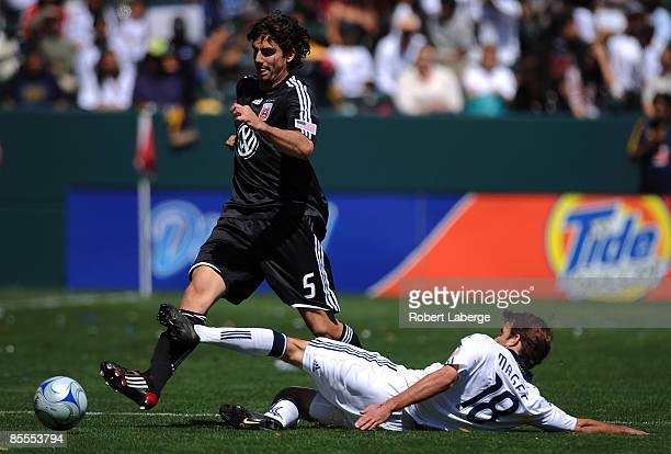 Dejan Jakovic of DC United fights for the ball with Mike Magee of the Los Angeles Galaxy at the Home Depot Center on March 22 2009 in Carson...