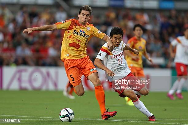 Dejan Jakovic of Shimizu SPulse and Kensuke Nagai of Nagoya Grampus compete for the ball during the JLeague match between Shimizu SPulse and Nagoya...
