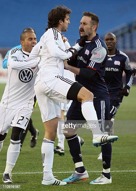 Dejan Jankovic of DC United and Ryan Cochrane of the New England Revolution go after each other as Fred of the United joins in on March 26 2011 at...
