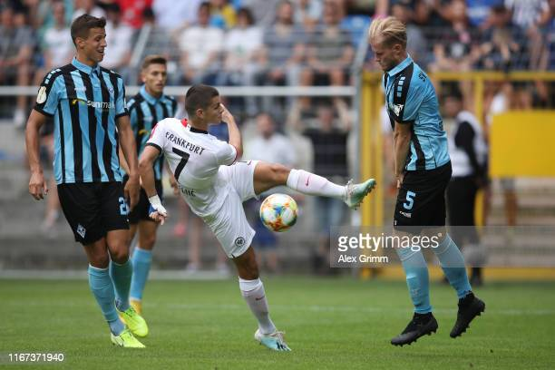 Dejan Joveljic of Frankfurt is challenged by Marcel Seegert of Mannheim during the DFB Cup first round match between SV Waldhof Mannheim and...