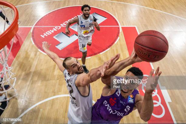 Dejan Kovacevic of HAKRO Merlins Crailsheim tries to block Dominic Lockhart of BG Goettingen during the EasyCredit Basketball Bundesliga match...