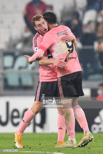 Dejan Kulusevski of Juventus celebrates a goal with team mate Alvaro Morata during the Serie A match between Juventus and Hellas Verona FC at Allianz...