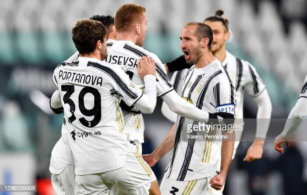 Dejan Kulusevski of Juventus F.C. Celebrates with teammates Giorgio Chiellini and Manolo Portanova after scoring their team's first goal during the...