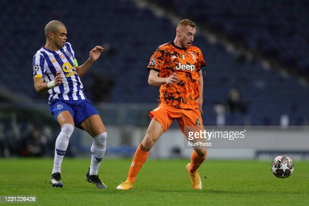 Dejan Kulusevski of Juventus FC in action with Porto's Portuguese defender Pepe during the UEFA Champions League round of 16 - 1st leg match between...