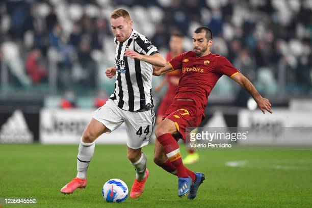 Dejan Kulusevski of Juventus is challenged by Henrikh Mkhitaryan of AS Roma during the Serie A match between Juventus and AS Roma at on October 17,...