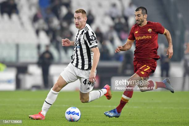 Dejan Kulusevski of Juventus is challenged by Henrikh Mkhitaryan of AS Roma during the Serie A match between Juventus and AS Roma at Allianz Stadium...