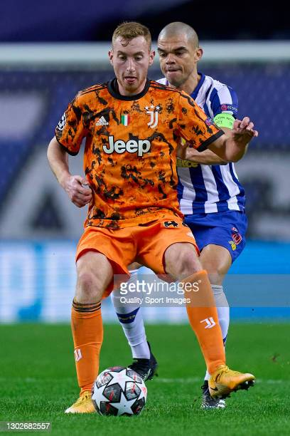 Dejan Kulusevski of Juventus is challenged by Kepler Lima 'Pepe' of FC Porto during the UEFA Champions League Round of 16 match between FC Porto and...