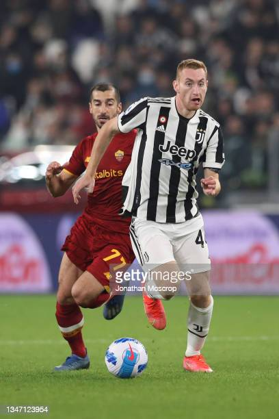 Dejan Kulusevski of Juventus is pursued by Henrikh Mkhitaryan of AS Roma during the Serie A match between Juventus and AS Roma at on October 17, 2021...