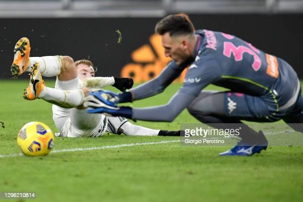 Dejan Kulusevski of Juventus kicks the ball past Alberto Paleari of Genoa CFC during the Coppa Italia match between Juventus and Genoa CFC at Allianz...
