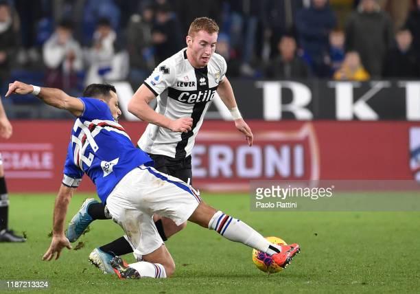 Dejan Kulusevski of Parma Calcio and Fabio Quagliarella of UC Sampdoria during the Serie A match between UC Sampdoria and Parma Calcio at Stadio...
