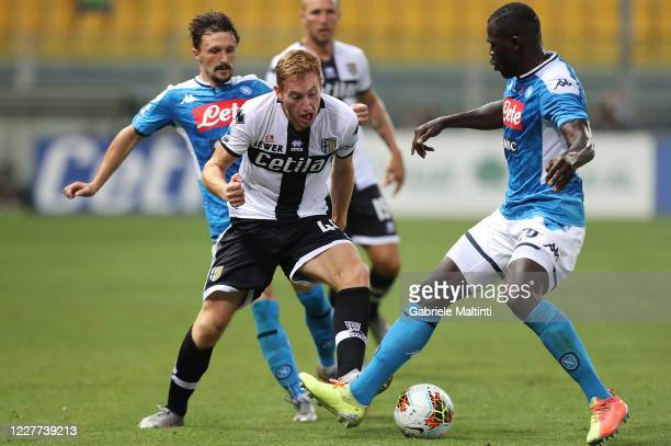 Dejan Kulusevski of Parma Calcio battles for the ball with Kalidou Koulibay of SSC Napoli during the Serie A match between Parma Calcio and SSC...