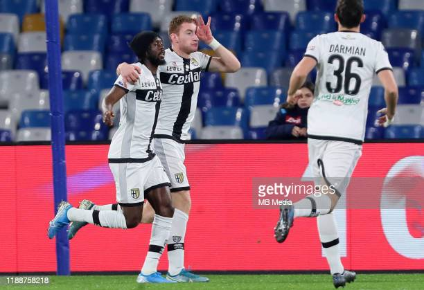 Dejan Kulusevski of Parma Calcio celebrates after his goal with teammates Gervinho and Matteo Darmian during the Serie A match between SSC Napoli and...