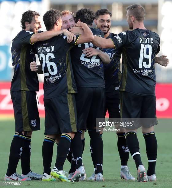Dejan Kulusevski of Parma Calcio celebrates his goal with his teammates during the Serie A match between Brescia Calcio and Parma Calcio at Stadio...