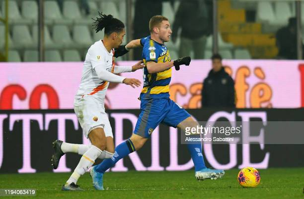 Dejan Kulusevski of Parma Calcio competes for the ball with Chrus Smalling of As Roma during the Coppa Italia match between Parma Calcio and AS Roma...