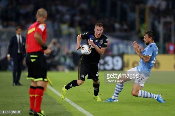 Dejan Kulusevski of Parma Calcio competes for the ball with Francesco Acerbi of SS Lazio during the Serie A match between SS Lazio and Parma Calcio...