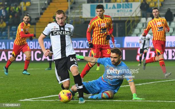 Dejan Kulusevski of Parma Calcio competes for the ball with Gabriel of US Lecce during the Serie A match between Parma Calcio and US Lecce at Stadio...