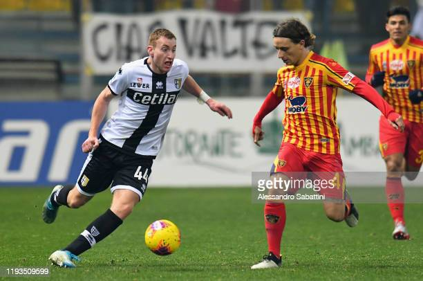Dejan Kulusevski of Parma Calcio competes for the ball with Jacopo Petriccione of US Lecce during the Serie A match between Parma Calcio and US Lecce...